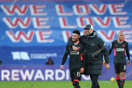 Liverpool's manager Jurgen Klopp, right, celebrates with Liverpool's Alex Oxlade-Chamberlain at the end of the English Premier League soccer match between Crystal Palace and Liverpool at Selhurst Park stadium in London, . Liverpool won the match 0-7