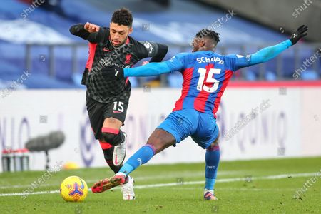 Alex Oxlade-Chamberlain (L) of Liverpool in action against Jeffrey Schlupp (R) during the English Premier League soccer match between Crystal Palace and Liverpool FC in London, Britain, 19 December 2020. EDITORIAL USE ONLY. No use with unauthorized audio, video, data, fixture lists, club/league logos or 'live' services. Online in-match use limited to 120 images, no video emulation. No use in betting, games or single club/league/player publications.