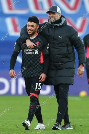 Liverpool manager Juergen Klopp (R) reacts with Alex Oxlade-Chamberlain (L) after the English Premier League soccer match between Crystal Palace and Liverpool FC in London, Britain, 19 December 2020.