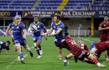 Clermont Auvergne vs Munster. Clermont Auvergne's Jean-Pascal Barraque is tackled by Conor Murray of Munster