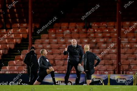 Grimsby Town manager Ian Holloway confronting Referee Darren Drysdale after the EFL Sky Bet League 2 match between Grimsby Town FC and Scunthorpe United at Blundell Park, Grimsby