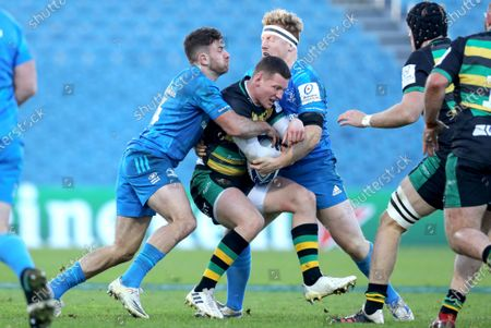 Leinster vs Northampton Saints. Northampton Saints' Fraser Dingwall is tackled by Robbie Henshaw and James Tracy of Leinster