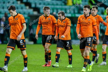 Goalscorer Luke Bolton (#20) of Dundee Utd FC is all smiles as he leaves the field with Paul McMullan (#7) of Dundee Utd FC after the final whistle of the SPFL Premiership match between Hibernian FC and Dundee United FC at Easter Road Stadium, Edinburgh