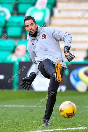 Stock Image of Dundee Utd goalkeeping coach, Neil Alexander during the warm up before SPFL Premiership match between Hibernian FC and Dundee United FC at Easter Road Stadium, Edinburgh