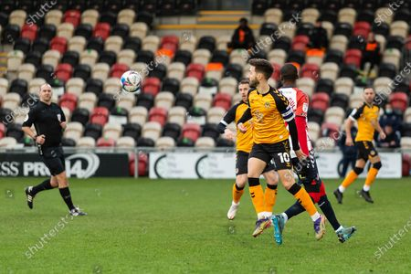 Newport County's Captain Josh Sheehan (10) holds off the challenge from Oldham Athletic's Dylan Baham Boula (24) during the EFL Sky Bet League 2 match between Newport County and Oldham Athletic at Rodney Parade, Newport