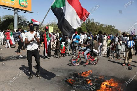 Protesters gather during a demonstration, in Khartoum, Sudan, . Protests in Sudan's capital and across the country are demanding a faster pace to democratic reforms, in demonstrations that are marking the two-year anniversary of the uprising that led to the military's ouster of strongman Omar al-Bashir