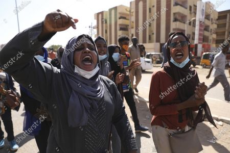 Protesters gather in Khartoum, Sudan, . Protests in Sudan's capital and across the country are demanding a faster pace to democratic reforms, in demonstrations that are marking the two-year anniversary of the uprising that led to the military's ouster of strongman Omar al-Bashir