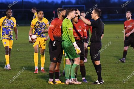 Mickleover goalkeeper Callum Hawkins booked during the Northern Premier League match between Mickleover and Radcliffe Borough at Don Amott Arena, Mickleover