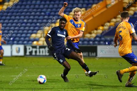 George Lapslie (32) of Mansfield Town and Southend United Richard Taylor (22) during the EFL Sky Bet League 2 match between Mansfield Town and Southend United at the One Call Stadium, Mansfield