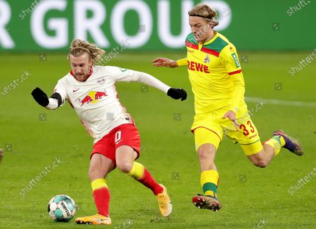 Leipzig's Emil Forsberg, left, and Cologne's Sebastiaan Bornauw, right, challenge for the ball during the German Bundesliga soccer match between RB Leipzig and 1. FC Cologne in Leipzig, Germany