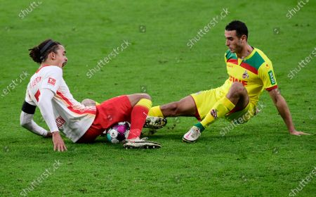 Yussuf Poulsen of RB Leipzig  battles for possession with Ellyes Skhiri of 1.FC Koeln (R) during the Bundesliga match between RB Leipzig and 1. FC Cologne at Red Bull Arena in Leipzig, Germany, 19 December 2020.
