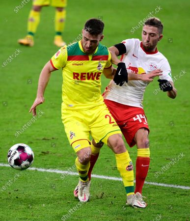 Ellyes Skhiri of 1.FC Koeln  battles for possession with Kevin Kampl of RB Leipzig (R) during the Bundesliga match between RB Leipzig and 1. FC Cologne at Red Bull Arena in Leipzig, Germany, 19 December 2020.