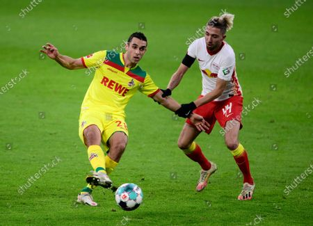 Ellyes Skhiri of 1.FC Koeln  is put under pressure by Kevin Kampl of RB Leipzig (R) during the Bundesliga match between RB Leipzig and 1. FC Cologne at Red Bull Arena in Leipzig, Germany, 19 December 2020.