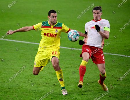 Ellyes Skhiri of 1.FC Koeln  is put under pressure by Marcel Sabitzer of RB Leipzig (R) during the Bundesliga match between RB Leipzig and 1. FC Cologne at Red Bull Arena in Leipzig, Germany, 19 December 2020.