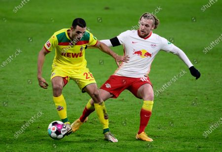 Ellyes Skhiri of 1. FC Koeln is challenged by Emil Forsberg of RB Leipzig (R) during the Bundesliga match between RB Leipzig and 1. FC Cologne at Red Bull Arena in Leipzig, Germany, 19 December 2020.