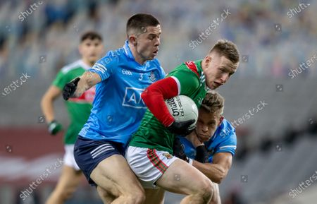 Stock Picture of Dublin vs Mayo. Dublin's David Byrne and Jonny Cooper with Ryan O'Donoghue of Mayo