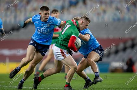 Dublin vs Mayo. Dublin's David Byrne and Jonny Cooper with Ryan O'Donoghue of Mayo