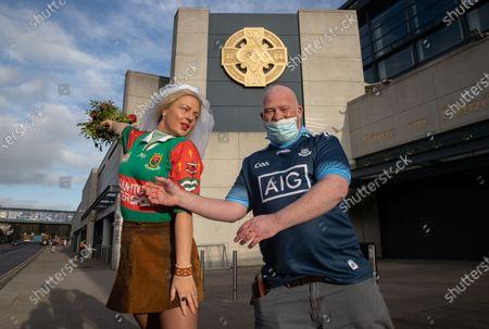 Dublin vs Mayo. Mayo fan Sophia Van Aalst from Wassenaar, The Netherlands with Dublin fan Dermot McGuckin on Jones' Road today