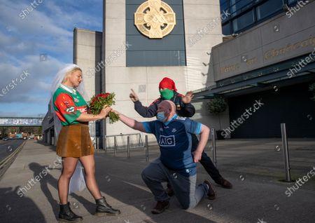 Dublin vs Mayo. Mayo fans Shane Fitzgerald from Kilmaine, Co Mayo with Sophia Van Aalst from Wassenaar, The Netherlands with Dublin fan Dermot McGuckin on Jones' Road today