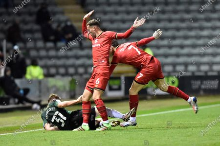 Luke Jephcott (31) of Plymouth Argyle is fouled by Baily Cargill (6) of Milton Keynes and Ben Gladwin (7) of Milton Keynes during the EFL Sky Bet League 1 match between Plymouth Argyle and Milton Keynes Dons at Home Park, Plymouth