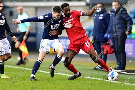 Millwall midfielder Shaun Williams (6)  and Nottingham Forest Forward Sammy Ameobi (11) battles for possession during the EFL Sky Bet Championship match between Millwall and Nottingham Forest at The Den, London