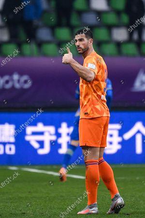 Graziano Pelle of Shandong Luneng gestures during the final match between Jiangsu Suning and Shandong Luneng at the CFA (The Chinese Football Association) Cup in Suzhou, east China's Jiangsu Province, Dec. 19, 2020.