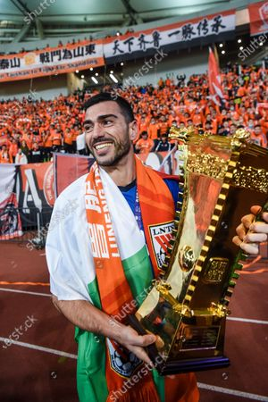 Graziano Pelle of Shandong Luneng holds the trophy after the awarding ceremony of the final match between Jiangsu Suning and Shandong Luneng at the CFA (The Chinese Football Association) Cup in Suzhou, east China's Jiangsu Province, Dec. 19, 2020.