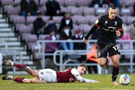 Lincoln City forward Ramirez Howarth (17) leaves Northampton Town forward Danny Rose (29) behind during the EFL Sky Bet League 1 match Northampton Town and Lincoln City at the PTS Academy Stadium, Northampton
