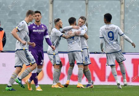 Hellas Verona's midfielder Miguel Veloso (C) celebrates with his teammates after scoring a goal during the Italian Serie A soccer match between ACF Fiorentina and Hellas Verona at the Artemio Franchi stadium in Florence, Italy, 19 December  2020.