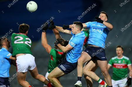 Dublin vs Mayo. Dublin's Brian Fenton and Philly McMahon clear a late high ball