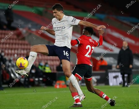 Manchester City's Rodrigo (L) in action against Southampton's Nathan Tella (R) during the English Premier League soccer match between Southampton FC and Manchester City in Southampton, Britain, 19 December 2020.