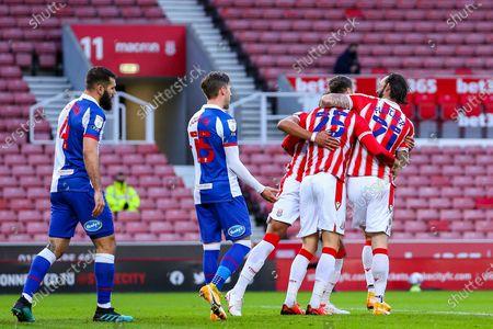 Goalscorer Nick Powell of Stoke City is congratulated by Steven Fletcher