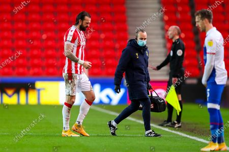 Steven Fletcher of Stoke City walks to the touchline after receiving treatment for an injury