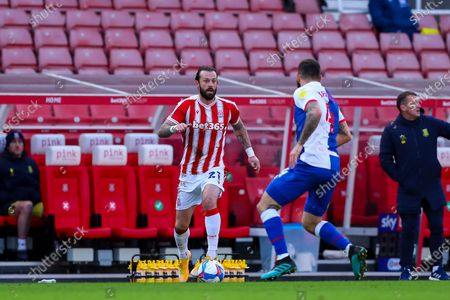 Steven Fletcher of Stoke City looks for options to attack the area