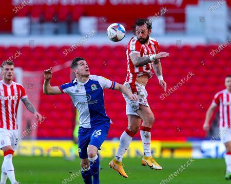 Steven Fletcher of Stoke City beats Darragh Lenihan of Blackburn Rovers to a header