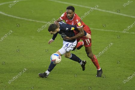 Shaun Williams of Millwall in a challenge with Sammy Ameobi of Nottingham Forest during the Millwall vs Nottingham Forest, EFL Championship Football match at the New Den London held behind closed doors