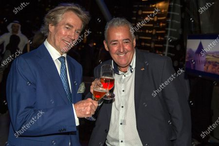 Neuschwansteiner Ambassador H.R.H. Prince Leopold of Bavaria and Mark Sutton (GBR) Sutton Images F1 Photographer at a Celebration of Six Years of the Abu Dhabi GP presented by Neuchwansteiner in aid of World Childhood Foundation at the Jumeirah Etihad Towers Hotel at Formula One World Championship, Rd19, Abu Dhabi Grand Prix, Preparations, Yas Marina Circuit, Abu Dhabi, UAE, Wednesday 25 November 2015.