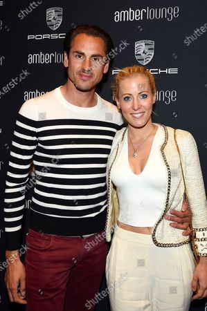 Stock Image of Adrian Sutil (GER) and girlfriend Jennifer Becks (GER) at Amber Lounge Fashion Show, Le Meridien Beach Plaza Hotel, Monaco, Friday 27 May 2016.