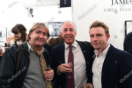 (L to R): Mark Dickens (GBR) Artist, Keith Sutton (GBR) Sutton Images CEO and Tom Hunt (GBR) at James Hunt, Girls, Beer and Victory Exhibition Official Opening, Proud Chelsea, London, England, 10 February 2016.