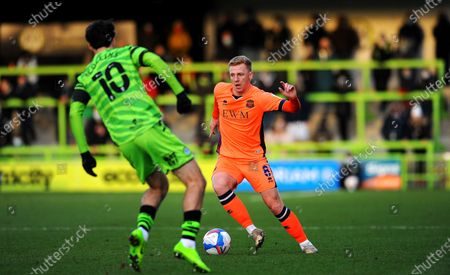 Callum Guy of Carlisle United tries to get past Aaron Collins of Forest Green Rovers- Mandatory by-line: Nizaam Jones/JMP