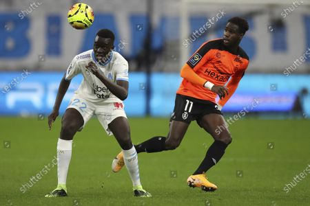 Stock Image of Marseille's Pape Gueye, left, controls the ball by Rennes' M'Baye Niang during the French League One soccer match between Marseille and Reims at the Stade Velodrome in Marseille, southern France
