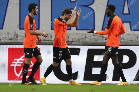 Stock Picture of Rennes' M'Baye Niang, right, celebrates with his teammate Dimitri Payet his goals against Marseille during the French League One soccer match between Marseille and Reims at the Stade Velodrome in Marseille, southern France