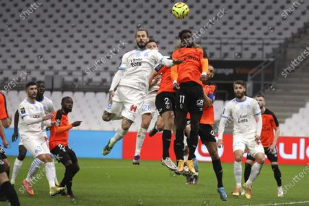 Marseille's Dario Benedetto, left, Marseille's Florian Thauvin, second left, jumps for the ball with Rennes' M'Baye Niang, right, during the French League One soccer match between Marseille and Reims at the Stade Velodrome in Marseille, southern France