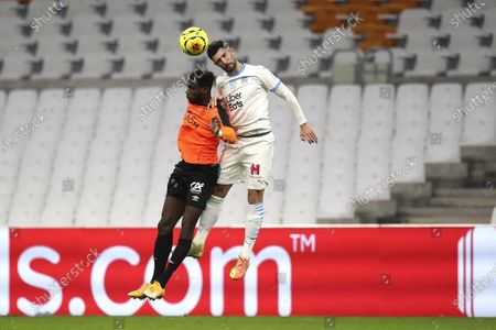 Marseille's Alvaro, right, jumps for the ball with Rennes' M' Baye Niang during the French League One soccer match between Marseille and Reims at the Stade Velodrome in Marseille, southern France