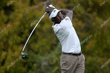 Vijay Singh, of Fiji, watches his tee shot on the 18th hole during the first round of the PNC Championship golf tournament, in Orlando, Fla