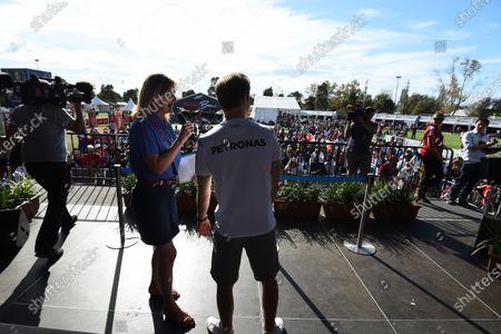 Nico Rosberg (GER) Mercedes AMG F1 on stage with Louise Goodman (GBR) Goodman Media at Formula One World Championship, Rd1, Australian Grand Prix, Preparations, Albert Park, Melbourne, Australia, Thursday 17 March 2016.