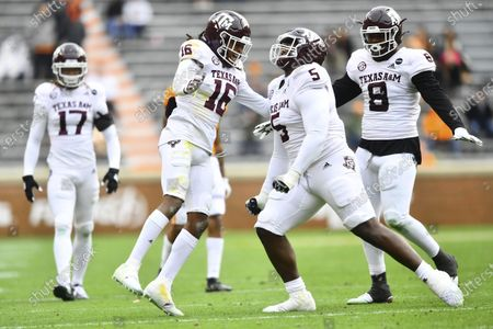 Texas A&M defensive back Brian George (16), and defensive linemen Bobby Brown III and DeMarvin Leal (8) celebrate against Tennessee during an NCAA college football game in Neyland Stadium in Knoxville, Tenn