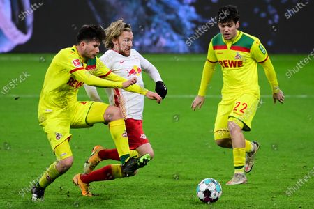 Emil Forsberg (R) of RB Leipzig competes for the ball with Elvis Rexhbecaj (L) of 1. FC Koeln during the German Bundesliga soccer match between RB Leipzig and 1. FC Cologne at Red Bull Arena in Leipzig, Germany, 19 December 2020.