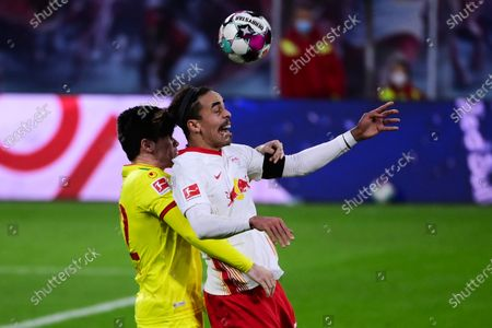 Stock Picture of Yussuf Poulsen (R) of RB Leipzig competes for the ball with Jorge Perez Mere (L) of 1. FC Koeln during the German Bundesliga soccer match between RB Leipzig and 1. FC Cologne at Red Bull Arena in Leipzig, Germany, 19 December 2020.