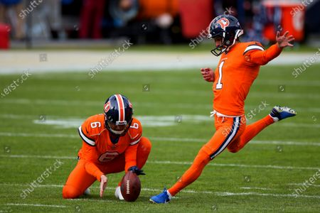 Denver Broncos place kicker Taylor Russolino (1) warms up by kicking a field goal on a hold by Sam Martin (6) against the Buffalo Bills before an NFL football game, in Denver